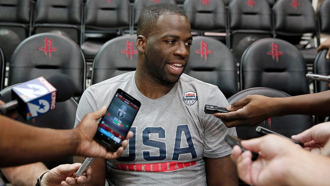 Draymond Green talks to the media before practice at Toyota Center.