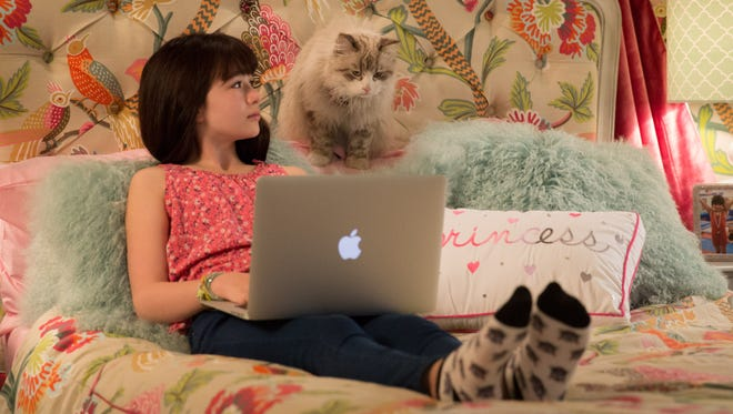 """Melina Weissman and Mr. Fuzzypants appear in a scene from """"Nine Lives."""""""