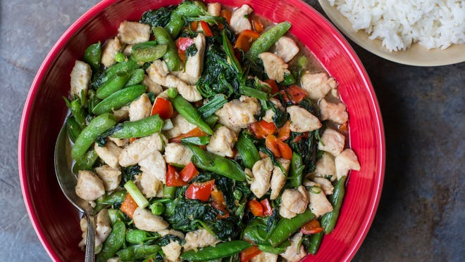 This November 2016 photo shows chicken and vegetable stir fry in New York. This dish is from a recipe by Katie Workman.