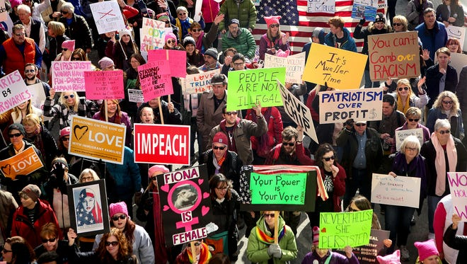 Thousands participate in the Cincinnati Women's March Saturday, January 20, 2018. Those in attendance stepped off from the Freedom Center just after 1:30 p.m. Saturday, the march taking them north on Race Street and back to the Freedom Center via Vine Street.
