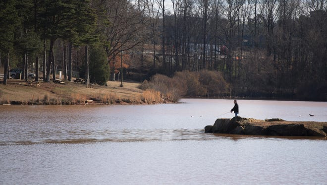Frank DiNicola of Simpsonville fishes at Oak Grove Lake Park on Friday, February 9, 2018.