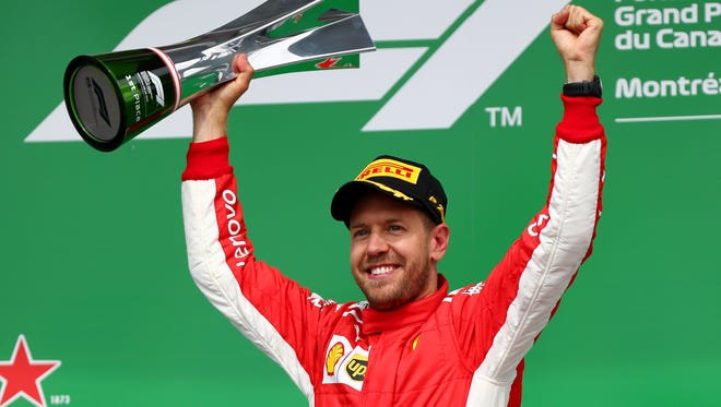 Sebastian Vettel celebrates with his trophy after winning the Canadian Grand Prix Sunday at Circuit Gilles Villeneuve in Montreal.