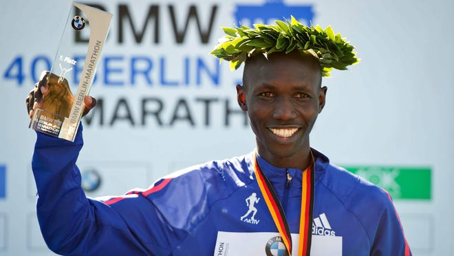 Wilson Kipsang celebrates during the medal ceremony of the 40th Berlin Marathon in Berlin, Germany, on Sunday. Kipsang set a world record for the marathon in Berlin Sunday. Kipsang runs an unofficial time of 2 hours 3 minutes 23 seconds.