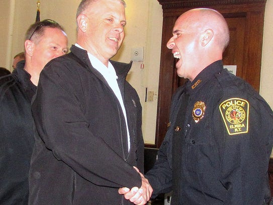 Elmira police Capt. Russell Andrews, right, shares