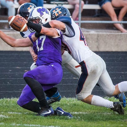 Central's Trenton Hatfield attempts to reach the end