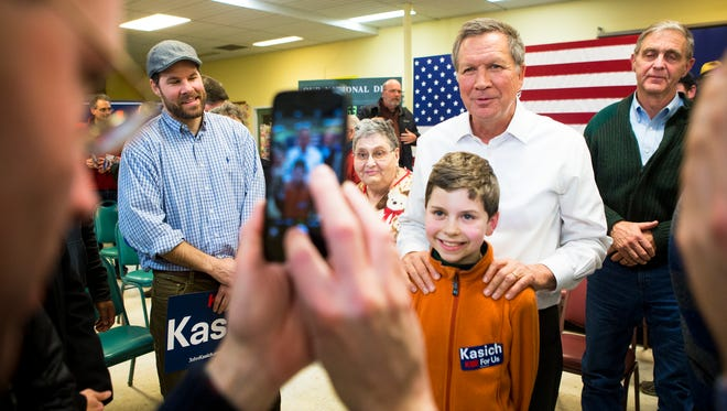 Ohio Governor John Kasich takes photos with families after a town hall at Lebanon Senior Center in Lebanon, New Hampshire Monday, January 18, 2016.