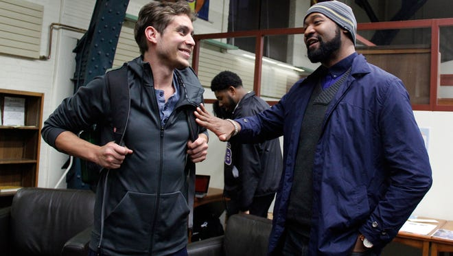 """Self-described as an """"older millennial,"""" Matthew Braunginn, left, a panelist at the Black and Brown Vote event at the University of Wisconsin-Madison, talks with Mike Martez Johnson of Progressive Dane, a local political party. The two were seen after the Oct. 12, 2016 event at the UW-Madison aimed at turning out millennial voters."""