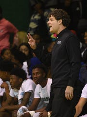 Bossier coach Nick Bohanan signals his team during Monday's game against Woodlawn.