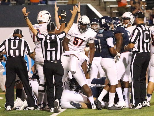 A referee signals UTEP's second touchdown against Rice