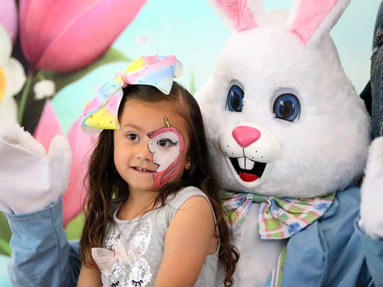 Emma Williams, 5, posed for a photo with the Easter Bunny at the El Paso Zoo's Eggstravaganzoo event last year.