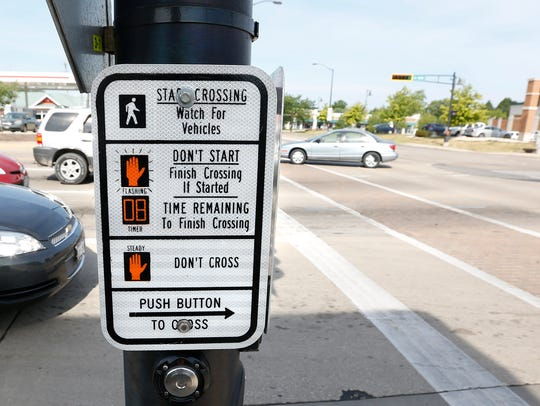 A pedestrian crossing signal at Main and Johnson streets will beep when pressed, but after that there is no audible signal to assist with crossing. Doug Raflik/USA TODAY NETWORK-Wisconsin