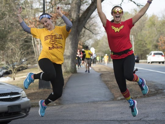 Maddie Perlewitz (right) and Rory O'Donnell did a 17-mile training run along the Boston Marathon route Saturday.