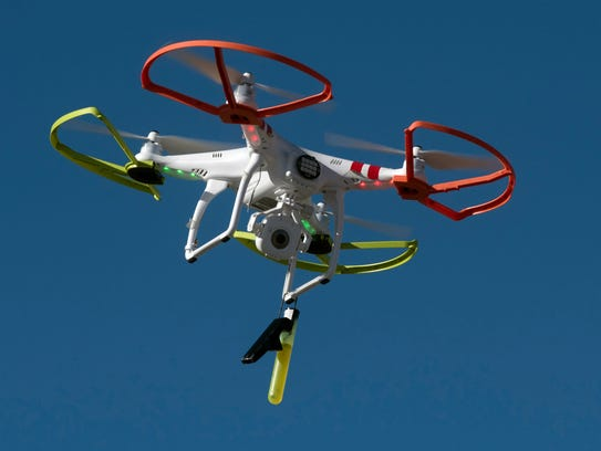 A small drone hovers around the pier area during a