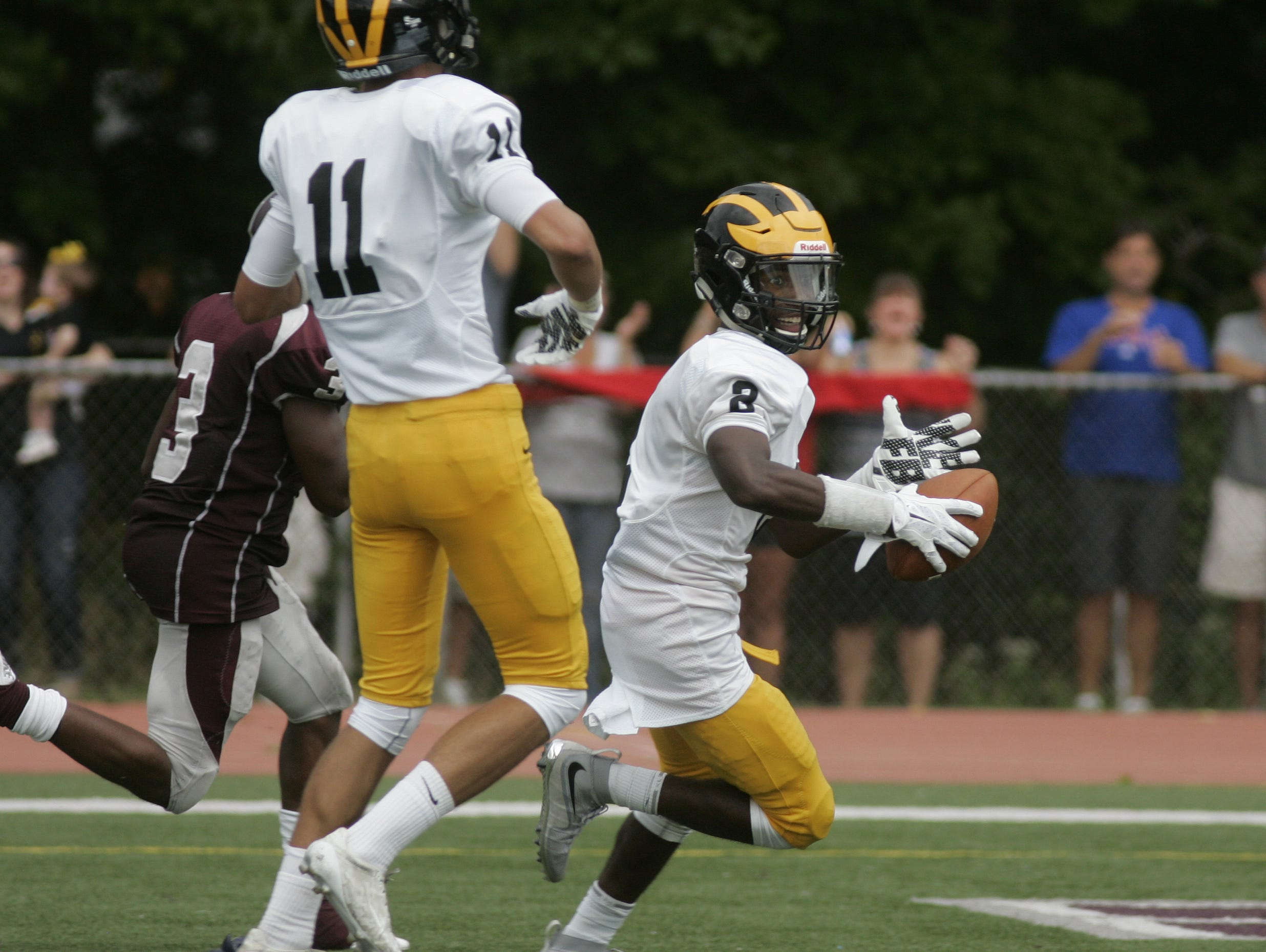 St. John Vianney wide receiver Khalil Haskins crosses the goal-line on a 48-yard touchdown pass from quarterback Anthony Brown late in the first half of the Lancers' 30-21 win at Matawan on Saturday