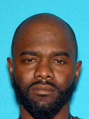In this undated photo provided by the Vallejo Police Department, Andrew Powell, 41, is seen. Powell targeted two Northern California police officers who were taking a break at a coffee shop in an ambush that was foiled when his gun malfunctioned, a police chief said Monday, Oct. 17, 2016. Powell, who was wearing body armor, fled when he could not get his weapon to fire, and the officers gave chase, shooting him three times, authorities said at a news conference. He is in critical but stable condition.