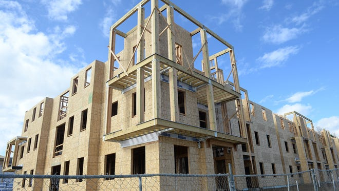 Construction continues on Crowne on South Timberline apartments on Timberline Road north of East Trilby Road on Thursday, November 5, 2015.