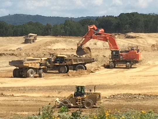 Earth is shown being moved over the summer as part of the operation under way to prepare land on the Department of Energy site in Piketon for a future on-site waste disposal site and associated support structures.