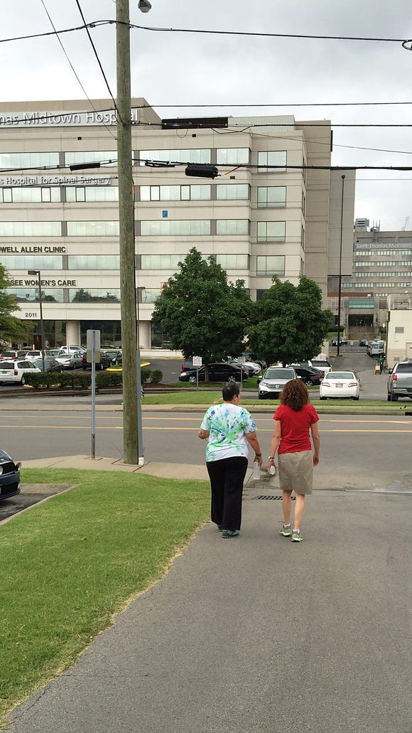 Beth Allen, right, often walks with people around Midtown