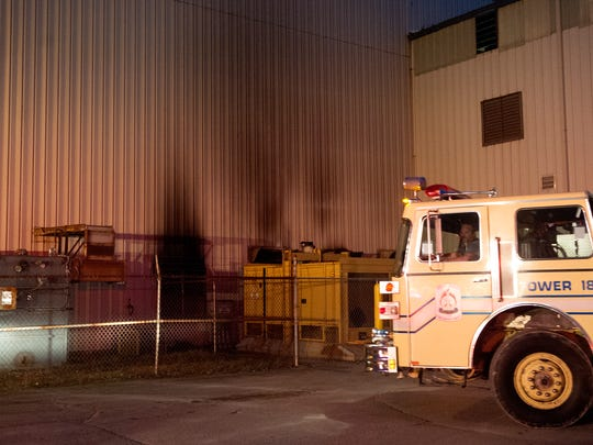 A Mount Gilead fire truck leaves a parking lot at Glen-Gery Brick plant in Iberia Monday night after a fire was successfully put out. The fire started in an air compressor room and a scorched wall can be seen from the outside.