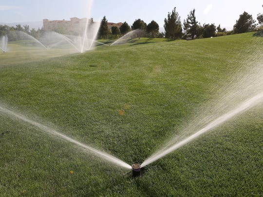 Large sprinklers irrigate turf at the Classic Club. The club recently began using a blend of recycled water and water from the Colorado River.
