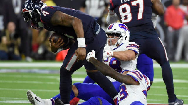 Deshaun Watson (4) breaks away from Buffalo Bills defenders Siran Neal (33) and Matt Milano (58) during overtime of the Houston Texans' AFC Wild Card Game. Watson completed a pass to set up Ka'imi Fairbairn's gamewinning field goal in a 22-19 victory Saturday.