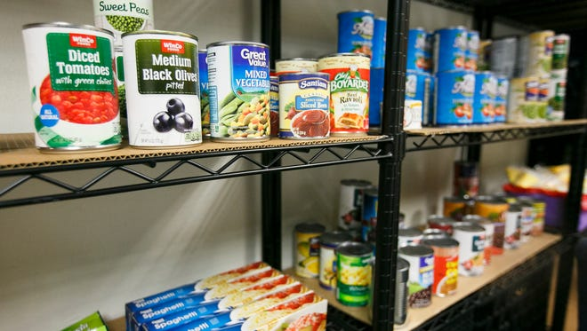 Shelves at Western Oregon University's food pantry are stocked with a variety of food items, including canned items and pasta. The pantry is open to students, staff and community members from Monmouth, Independence and Dallas.