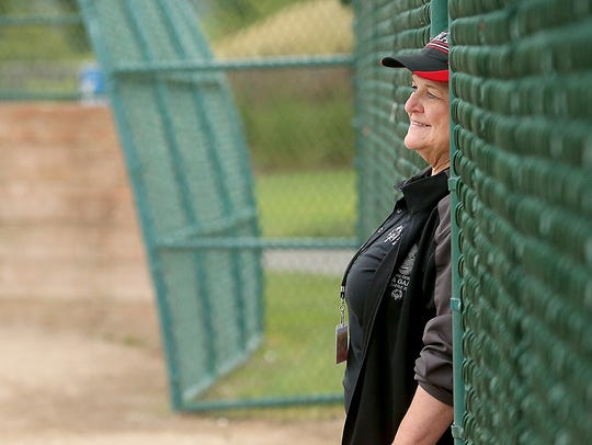 Coach Barb Pool watches her team play at Lions Park on June 22.
