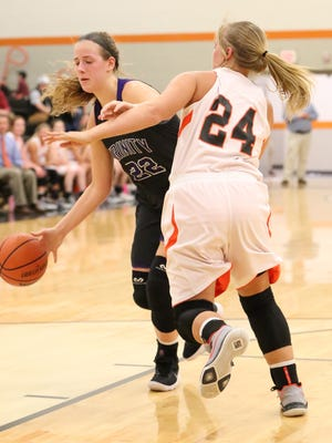 TCA's Savannah Lee (22) tries to get to the basket around Greenfield's Anna Dale Wright in the Region 7-A quarterfinals on Thursday.