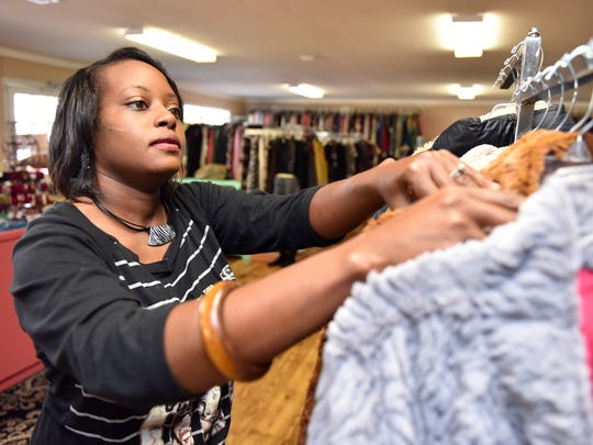 Jessica Griffin arranges coats at Trendy Treasures in Ridgeland.