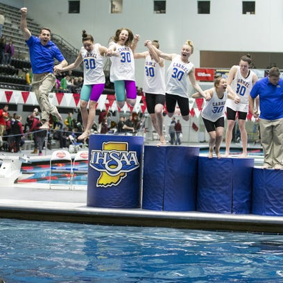 Carmel High School swimmers and coaches jump into the