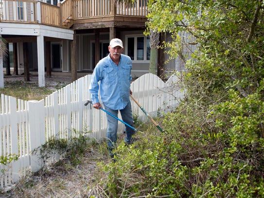Rick O'Connor of Florida Sea Grant searches a wooded