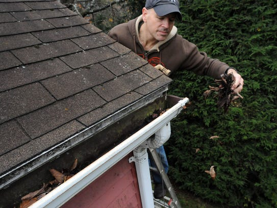 Cleaning out gutters before winter arrives is crucial.