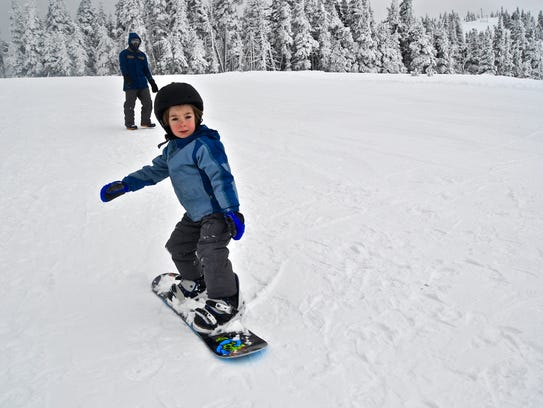 Kale Louderback, 4, tries snowboarding for the first