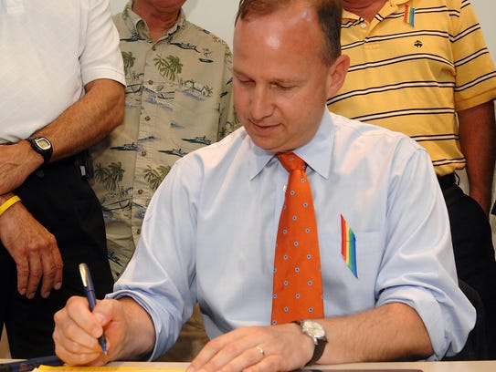 In this file photo, Gov. Jack Markell signs Senate