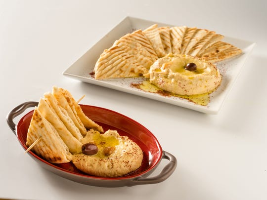 Zea Rotisserie & Grill's roasted garlic hummus is a crowd pleaser. Zea will be offering special cocktails for Mom on Mother's Day.