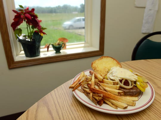 The Smokin' Jack Burger, a half-pound burger with banana peppers, caramelized onions, two slices of pepper jack cheese and two strips of bacon, is shown at Annie's Country Store & Restaurant in Chandlersville.