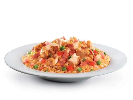 "The Arizona bowl at Muscle Maker Grill is grilled chicken and turkey bacon over brown rice with tomatoes, scallions and the restaurant's ""signature sauce."""