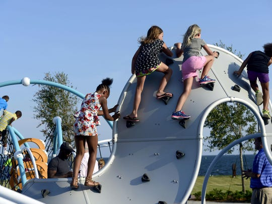 Kids try out brand new playground equipment at the Rotary Centennial Playground on Monday after a grand opening ceremony at Community Maritime Park. The playground and covered sitting area took about two years from drawings to completion. It was funded by a $100,000 Impact 100 grant and $500,000 raised by members of Rotary Club of Pensacola. The Rotary club funded the park in celebration of their 100th anniversary in Pensacola.
