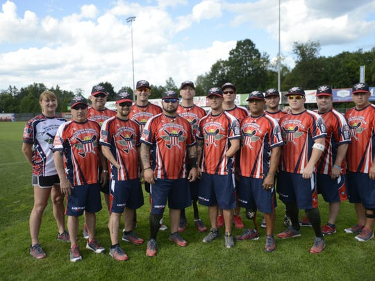 Members of the Wounded Warriors Amputee Softball Team pose for a group photo.