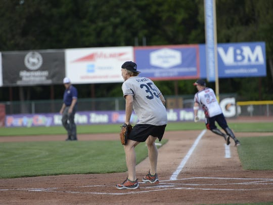 Rusty DeWees, comedian and actor from Elmore, playes catcher Saturday against the Wounded Warriors Softball Team.