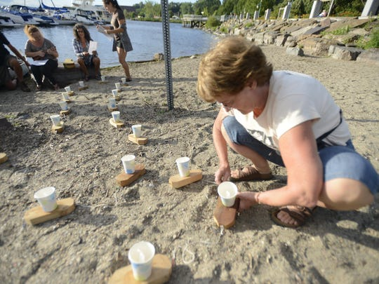 Wendy Coe, a founder of the Peace & Justice Center, prepares candle boats at the Burlington waterfront for the ceremony remembering the atomic bombing victims.