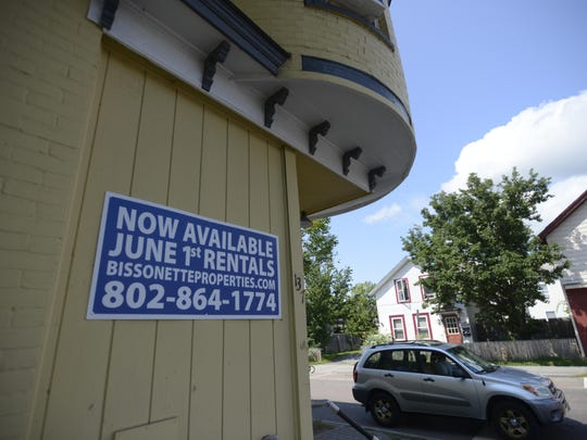 A sign advertises an apartment for rent by Burlington-based