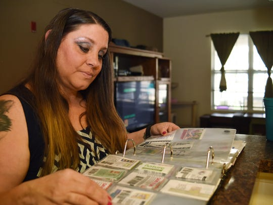 Michelle Abbott looks through her coupon book at her home in Fishkill.