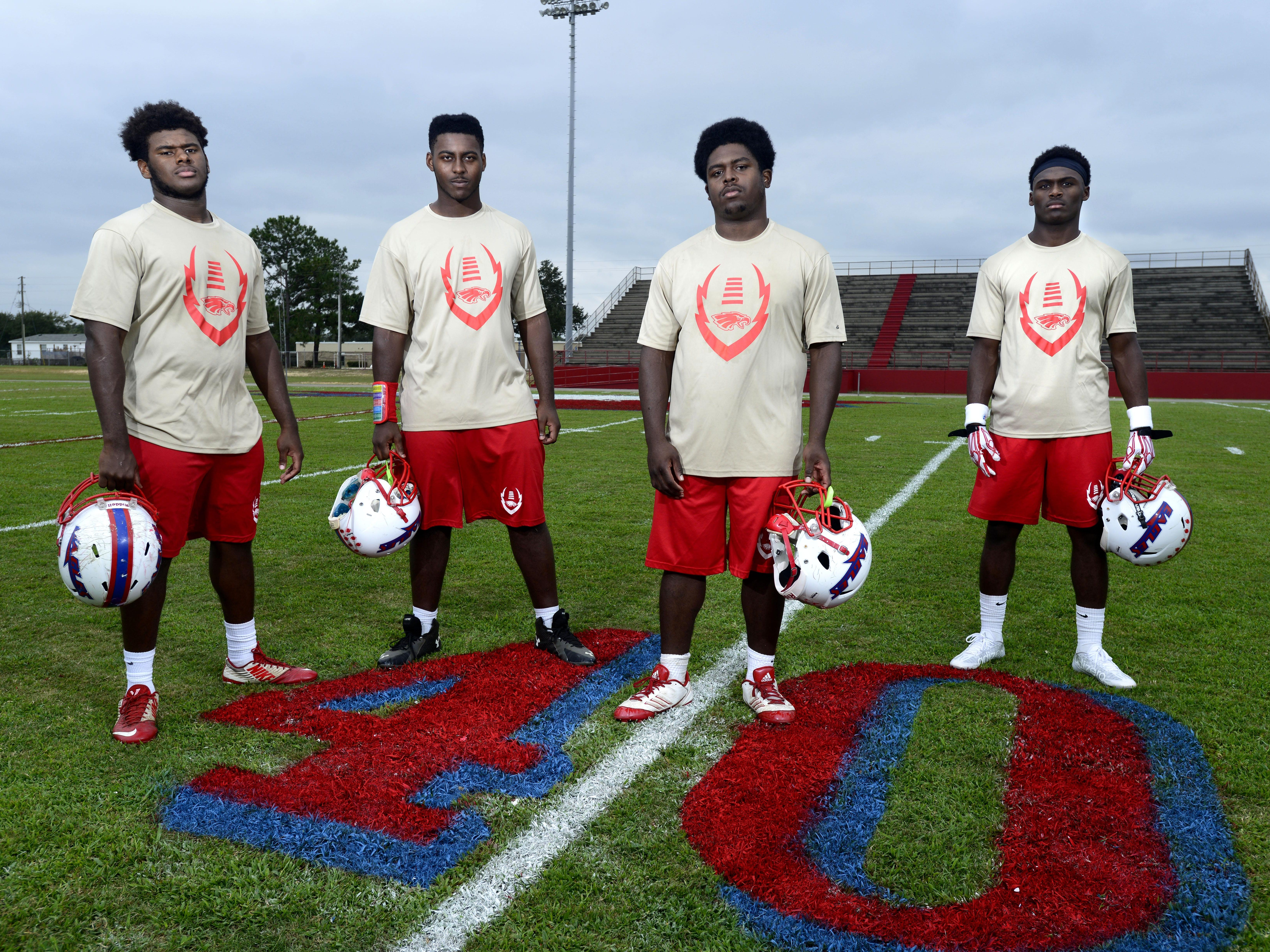 The Pine Forest Eagles are celebrating their 40th anniversary Friday as they host the Escambia Gators. Players, from left, are Jamarqus Miller, Derrick Clarke, Angelo Garay and Jaden Gardner.