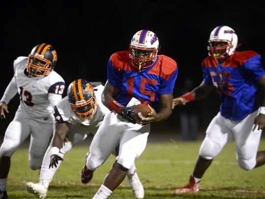 Pine Forest quarterback Xavier Saulsberry keeps the ball on homecoming night Friday while hosting Escambia High. The Eagles beat the Gators 21-17.