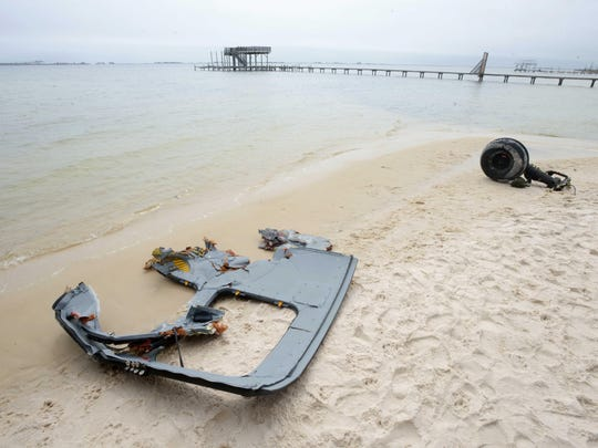 Portions of the crashed Black Hawk helicopter washed ashore near Navarre, Florida.