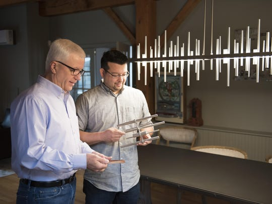 Bob Dillon, Hubbardton CEO, and David Kitts, design director, with Hubbardton Forge's Cityscape LED Pendant.