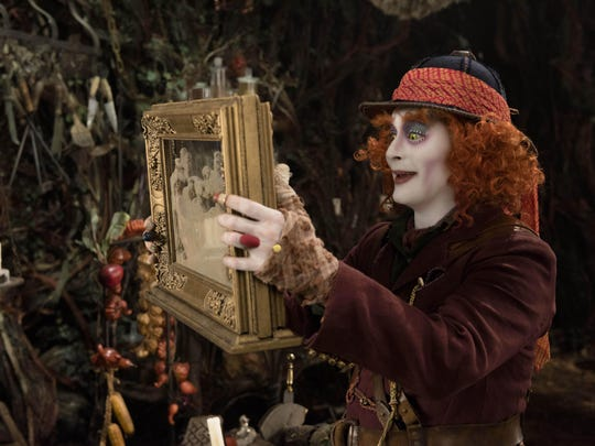 "Alice (Mia Wasikowska) returns to the whimsical world of Underland to help the Hatter (Johnny Depp) in ""Alice Through the Looking Glass."""
