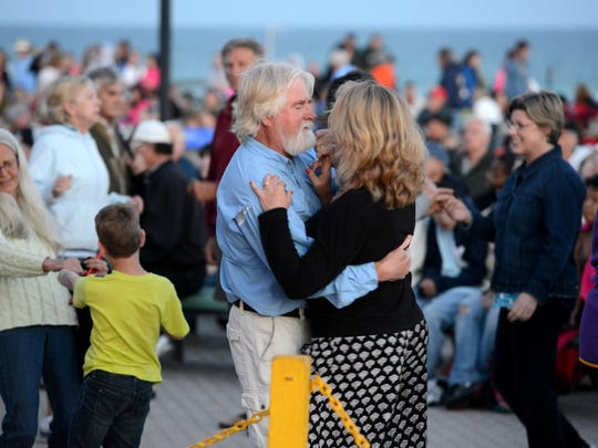 People dance to the sounds of live music at the Gulfside Pavilion on Pensacola Beach during a past Bands on the Beach.