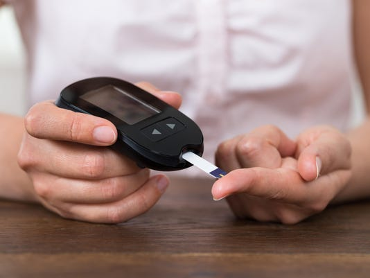 Person Hands Holding Glucometer
